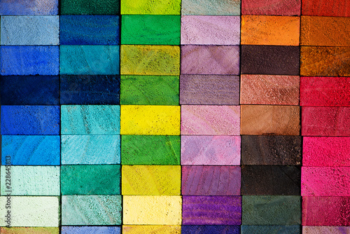 Leinwand Poster Spectrum of multi colored wooden blocks aligned