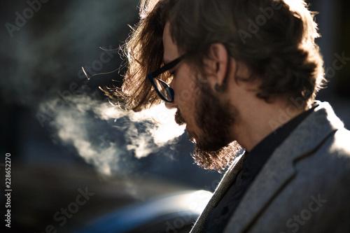 Foto  The man blows smoke