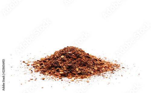Fotografia, Obraz  Crushed, ground red cayenne pepper, dried chili flakes and seeds isolated on whi