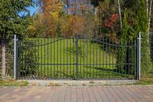 Metal Modern Gate In Autumn Scenery