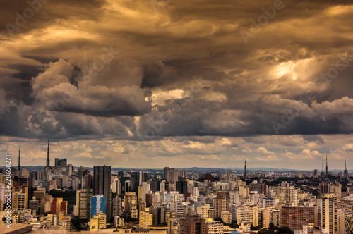 Fototapeten New York dramatic storm clouds over Sao Paulo skyline