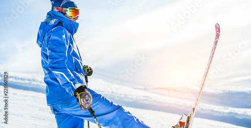 fototapeta na lodówkę Male athlete skiing in snow mountains on weekend holidays