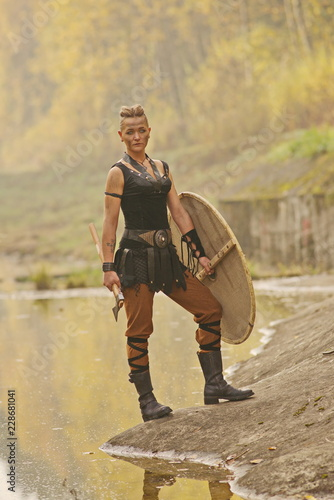 Photo  Viking woman with axe in a traditional warrior clothes
