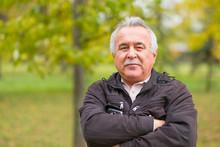 Portrait Of An Elderly Man In The Park.