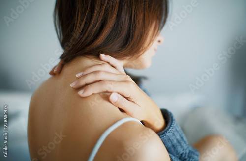 Fotografering Woman with neck or shoulder pain
