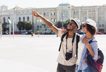 African-american Couple Of Tourists Sightseeing In City