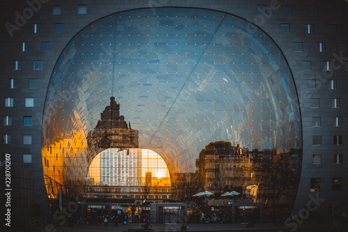 Spoed Fotobehang Rotterdam Reflection of cityscape in Rotterdam on the facade of Market Hall (Markthal) during golden hour