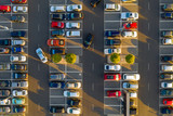 Top down view from drone on mall parking with many cars.