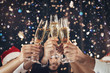 canvas print picture - Clinking glasses of champagne in hands at New Year party