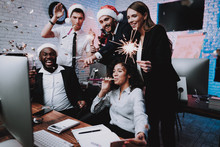 Young People Celebrating New Year In Modern Office