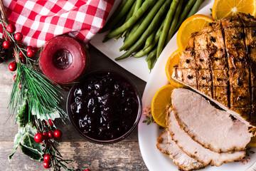 Fototapeta Tradicional homemade honey Glazed Ham for holidays. Top view
