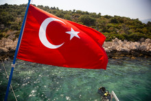 KAS, TURKEY First Time Diver With Instructor Beneath Turkish Flag.