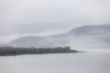 Foggy landscape fog on lake in the morning - Cold autumn winter grey day in Alaska. - 228730415