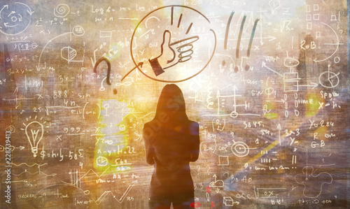 Young woman looking on the black board with mathematical formulas and calculations Poster Mural XXL