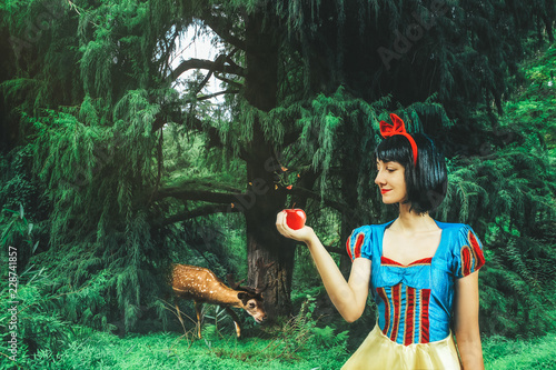 Fotografie, Obraz  Snow White cosplay girl in the mysterious forest