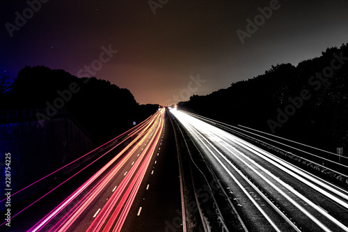 Foto op Canvas Nacht snelweg Moving cars