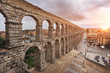 Dramatic sunset in famous Segovia aqueduct, Castilla y leon, Spain.