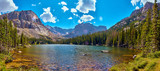 Photographer in Rocky Mountains The Noch lake with mountains panorama