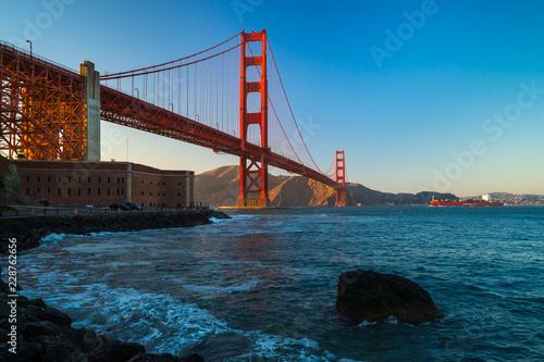 Photo  Suns setting Behind Golden Gate Bridge, Fort Point, San Francisco