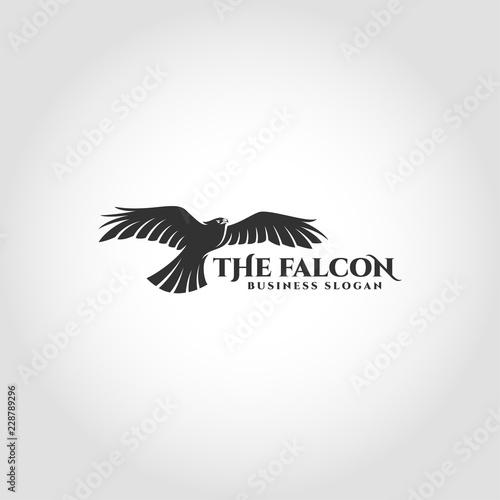 Photo  The Falcon is a bird logo with flying falcon concept