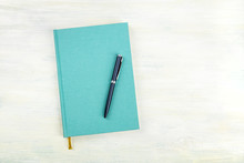 An Overhead Photo Of A Teal Blue Journal With A Pen, An Elegant Notebook Or Planner With A Place For Text