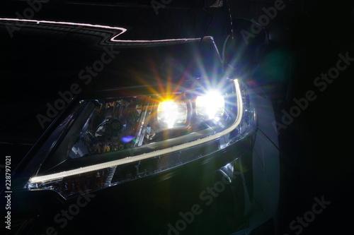 Obraz Angel eyes xenon headlight glowing optics lens - fototapety do salonu