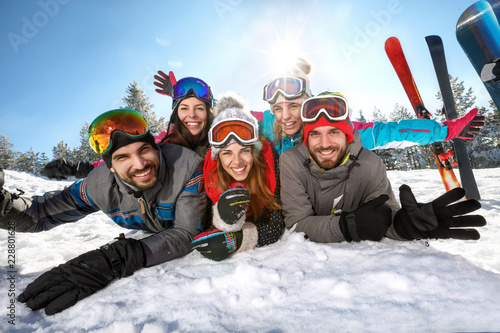 Happy skiers together on winter vacation