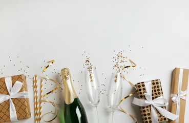 Creative flat lay composition with bottle of champagne and space for text on white background