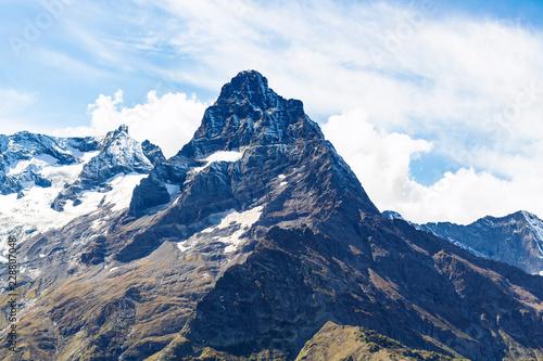 Deurstickers Asia land snow-covered mountain peak near Dombay village