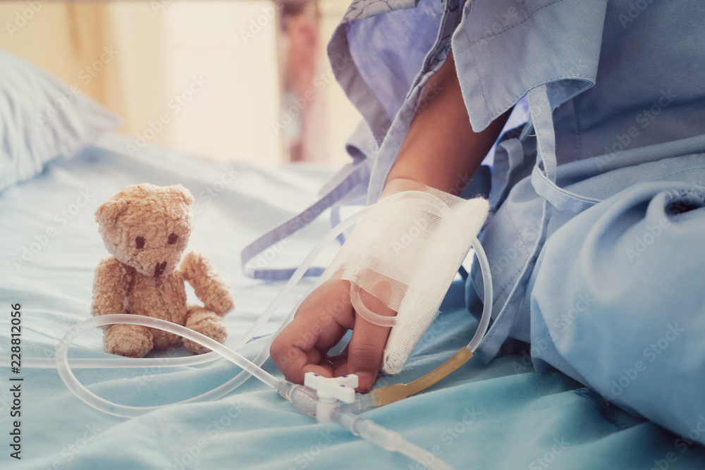 Fototapeta Mother holding child's hand who fever patients in hospital to give encouragement