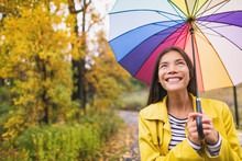 Woman Happy With Umbrella Unde...