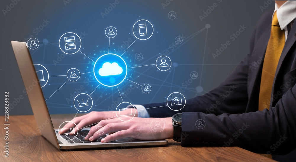 Fototapeta Businessman hand typing with cloud technology system and office symbol concept