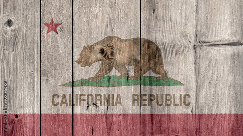 Fotografie, Obraz  USA Politics News Concept: US State California Flag Wooden Fence