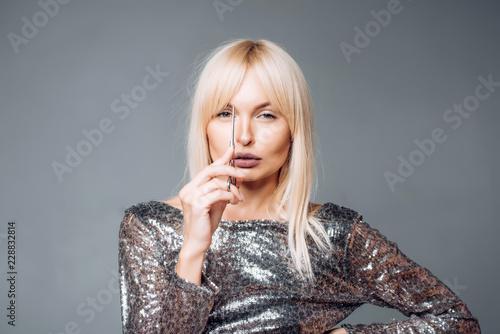 Photo Perfect Blonde girl cut forelock