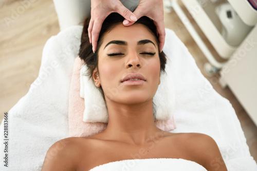 Fototapeta Woman receiving head massage in spa wellness center. obraz