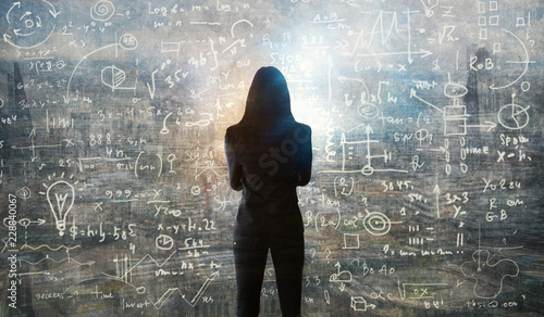 Fotomural Young woman looking on the black board with mathematical formulas and calculations