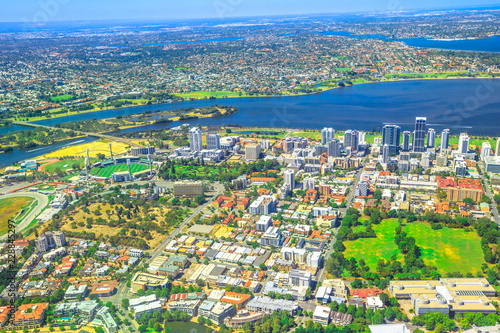 Aerial view of Perth Skyline and Heirisson Island in Australia. Scenic flight over the modern skyscrapers and Swan River in Western Australia.