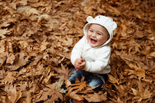 Happy Boy In Autumn Forest