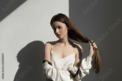 Canvastavla image of attractive woman showing her  long hair