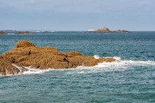 French Landscape - Bretagne. Panorama Of A Beautiful Rocky Coast With Ferry In The Background.