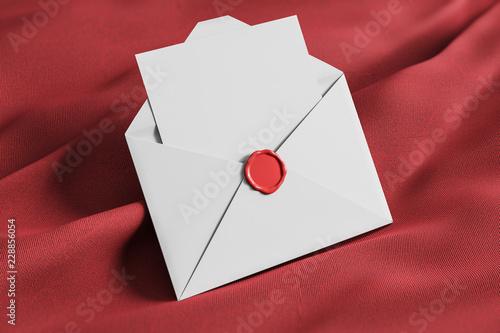 Open white envelope on red tissue