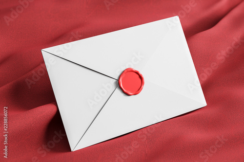 Closed white envelope on red tissue