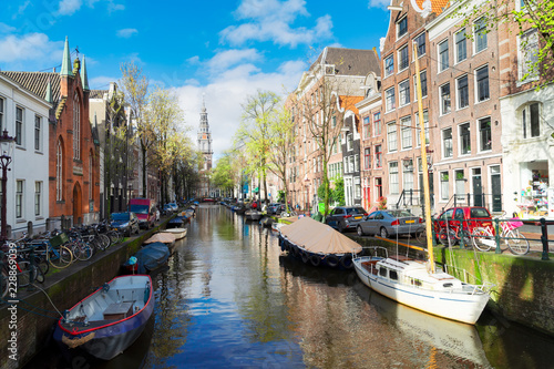 Photo  South Church Zuiderkerk and old Houses over canal with boats, Amsterdam, Netherl