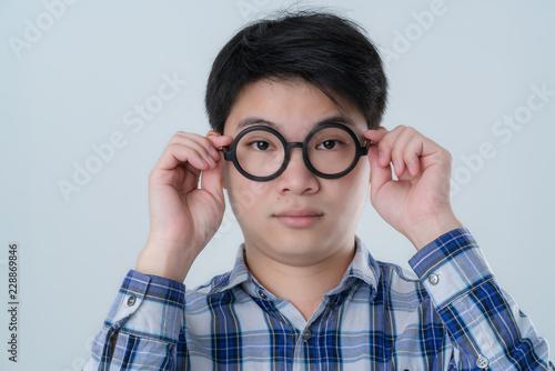 c25be024aaf nerd asian glasses men hand touch black round glasses white background