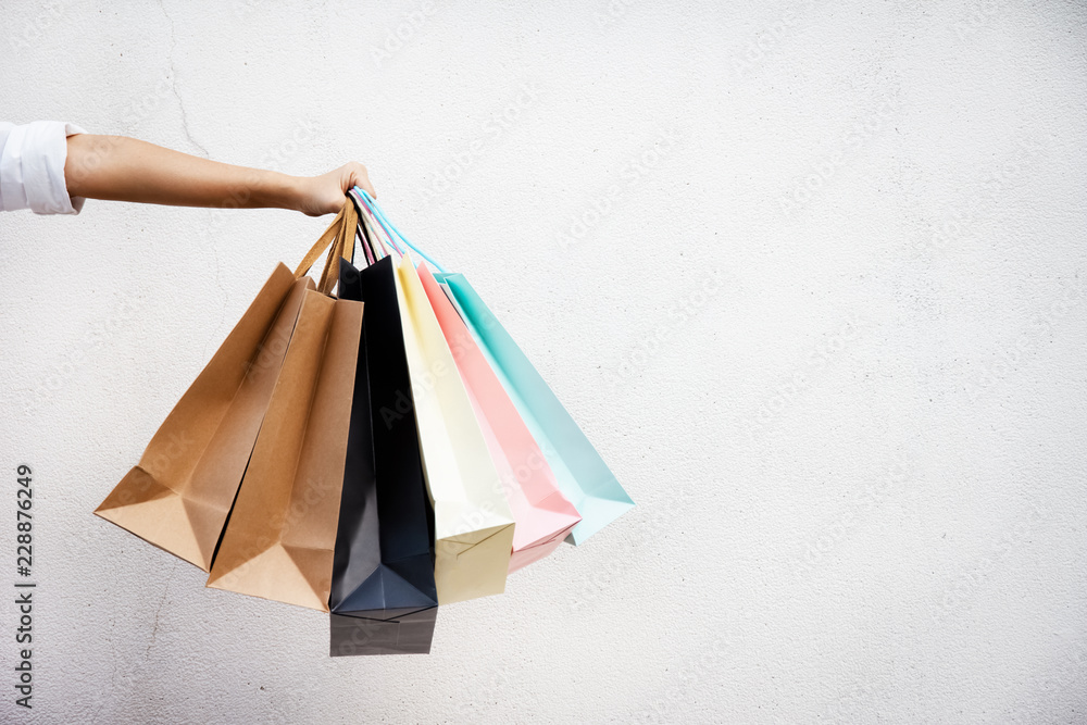Fototapeta Shopping bags of women crazy shopaholic person at shopping mall.colorful paper shopping bags.