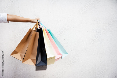 Shopping bags of women crazy shopaholic person at shopping mall.colorful paper shopping bags.