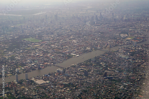 Staande foto Rotterdam Image of plane window View of the village from the bird's eye view, Bangkok City, Thailand.