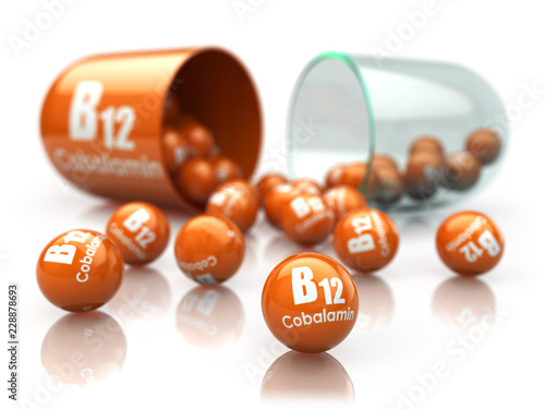 Fototapeta Vitamin B12 capsule isoilated on white. Pill with cobalamin. Dietary supplements. obraz