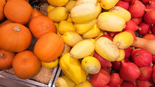 Variety Of Colorful Ornamental Pumpkins, Gourds And Squashes In Market For Halloween Holiday