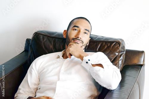 Fotografie, Obraz  Handsome Latino man in chair